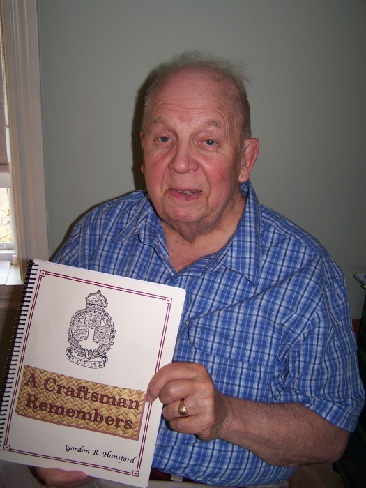 Gordon Hansford with his book on WWII