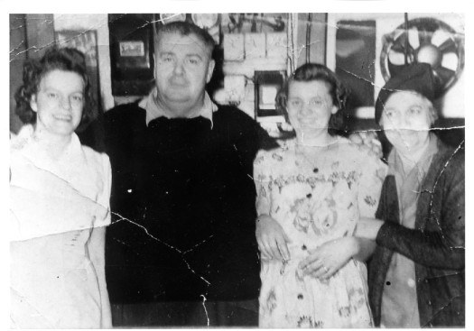 Elmer Skaling with wife Jennie and staff